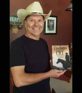 Shows me, the author, holding the first physical copy of my upcoming memoir - Cowboys Are Not Supposed to Cry